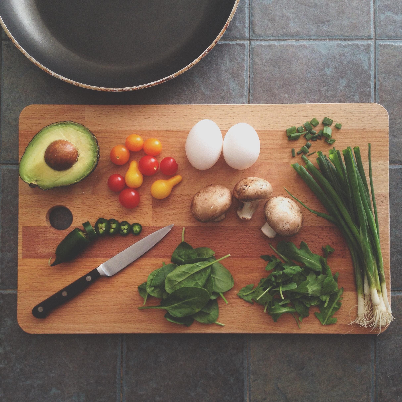 caterers cut veggies on a cutting board